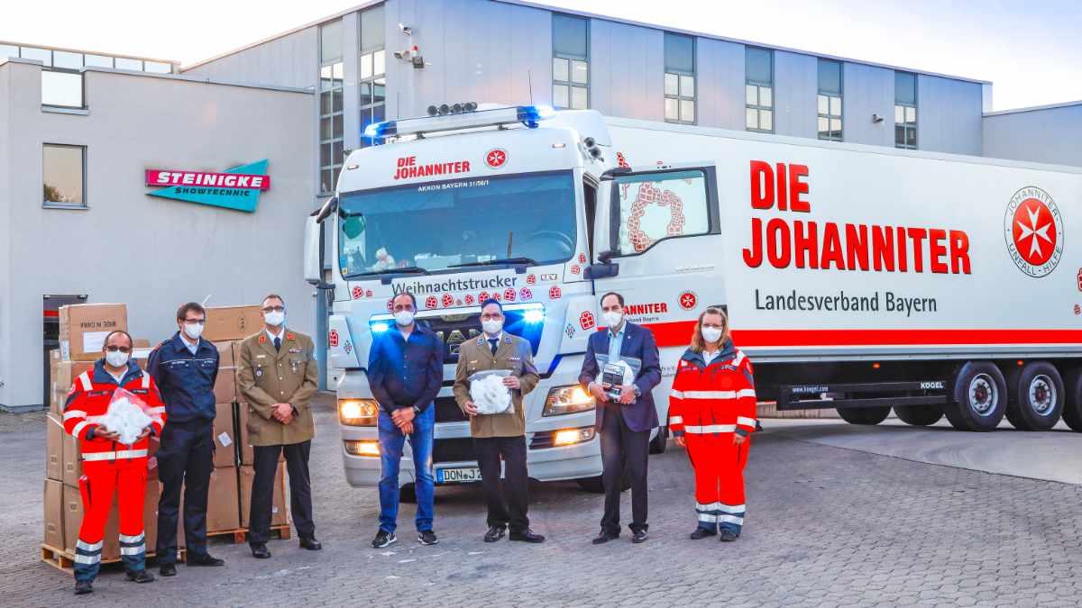 Steinigke Showtechnic übergibt 150.000 Schutzmasken an die Johanniter